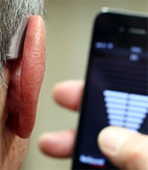 Man with hearing aid technology